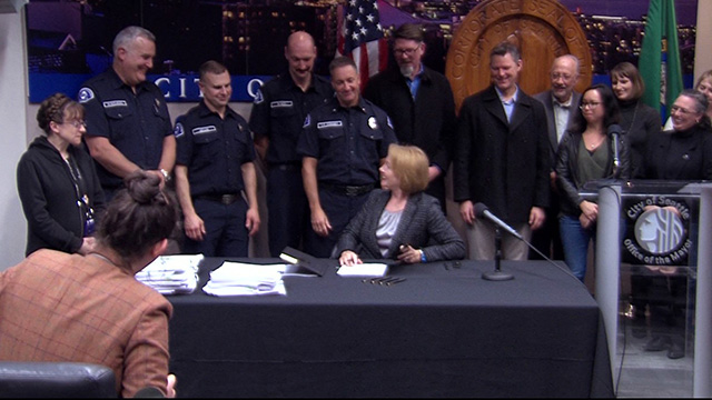 Mayor Durkan signs contracts for firefighters, represented employees